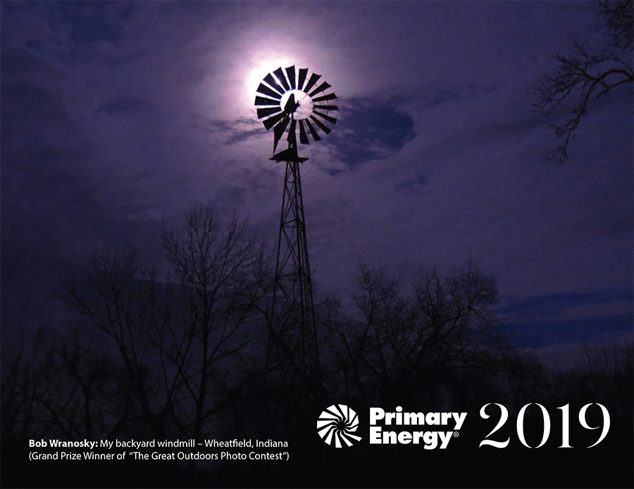 Image of Primary Energy 2019 Employee Calendar, photo of a windmill backlit by moonlight through thin clouds
